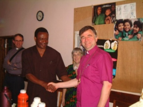 Col. E Mfuru, DC of Mpwapwa District shakes hands with +Brian Castle - Link Partners from the Diocese of Rochester in the UK