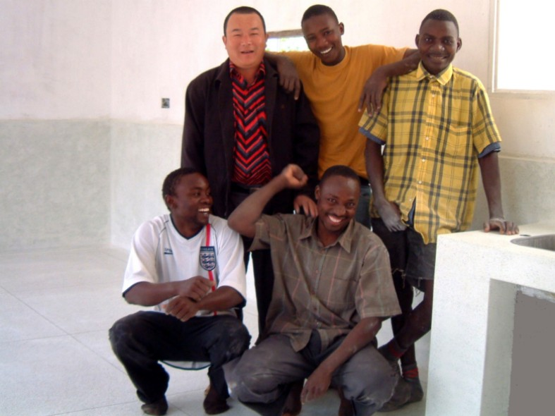 The Hainan Terrazzo Team: Top Row from Left - Mr Zao (Foreman), Stivu Mawazo, and Aberd Mtango.  Bottom Row from Left - Robert Thomas and Willy Andreus.