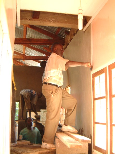 The Site Manager, Jospeh Mlulu, Ensures a Good Joint with the Delivery Suite Plasterwork