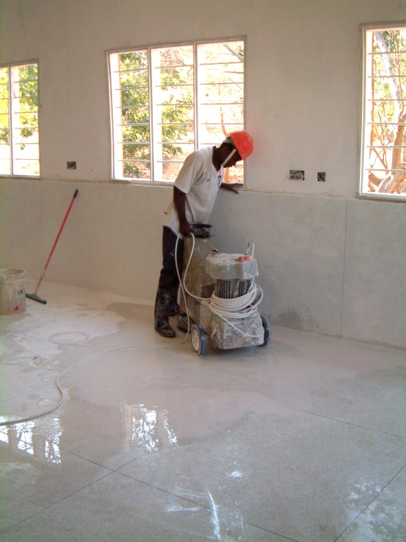 Grinding the new floor to a fine polish