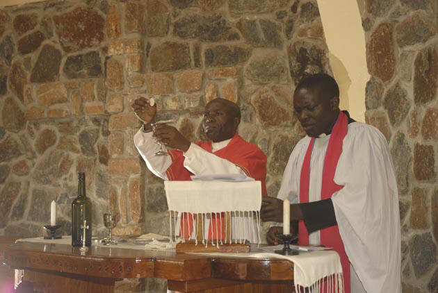 Canon John Madihi celebrates communion in St. Luke's Chapel