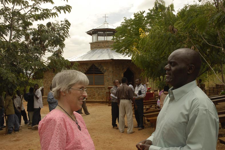 Rachel Speaks to Joseph Mlulu following the consecration of St. Luke's Chapel