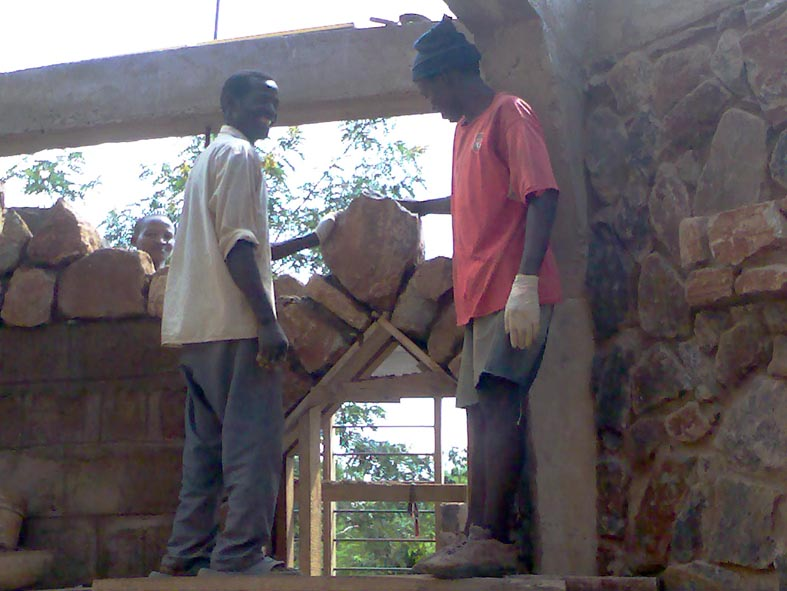 Placement of Keystone to Internal Door Arch by Mason Mwangale (right) and his assistant