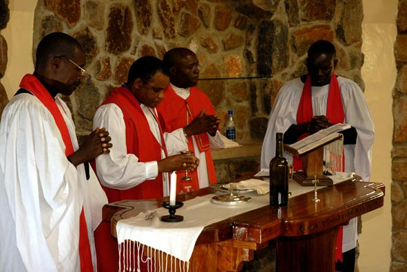 +Jacob Chimeledya & Can. John Madihi conduct the first communion in St. Luke's Chapel